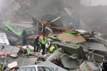 Police search through rubble of the collapsed CTV building. Photo / Geoff Sloan