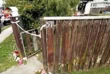 Flowers and cards were left for the family who lived in the Maxwell St house on Durie Hill that was extensively burned early on Tuesday afternoon. Photo / Wanganui Chronicle