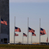 American flags surrounding the Washington Monument in Washington are lowered to half-staff in a mark of respect for the victims on the Connecticut elementary school shootings. Photo / AP