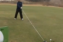 American golfer Michael Furrh is claiming an 'unofficial Guinness World record' after hitting a golf ball 144 yards at the Rolling Hills Golf Club. Photo / Youtube.