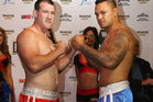 Paul Gallen (L) and Hika Elliot face off during the Fight for Life Weigh In. Photo / Getty Images.
