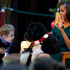 A.J. Murray, left, peeks in close at first dog Bo, as first lady Michelle Obama, answers questions from children who are patients at the Children's National Medical Center in Washington. Photo / AP