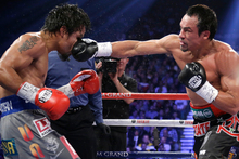 Mexico's Juan Manuel Marquez knocked Manny Pacquiao out cold with a vicious right hand at the end of the sixth round. Photo / AP