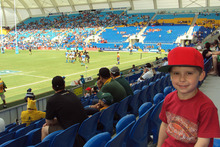 Four-year old Theo Dann enjoys a day at the Gold Coast Sevens. Photo / Liam Dann