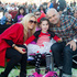 Penny, Portia and Matt Swan enjoy the show at Coca-Cola Christmas In The Park in the Auckland Domain. Photo / Michelle Hyslop