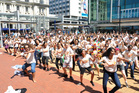 Hundreds of young people gather in QE Square.  Photo / Steven McNicholl