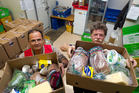 Dimitri Germanov and Ray Murphy prepare food parcels for the needy. Photo / Sarah Ivey