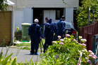 Police detectives working at the scene of a suspicious death in Papakura. Photo / Sarah Ivey