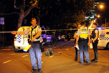 Traffic was diverted in Melbourne after a man fled with a gun. Photo / Herald Sun
