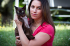 Vanessa Wheeler with her cat Senna, who has a pellet in her shoulder after being shot with an airgun by an unknown attacker. Photo / Natalie Slade
