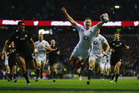 England's Chris Ashton sails through the air as he scores during the final All Blacks match of the 2012 Northern Hemisphere tour Photo / Getty Images