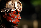 A village woman wearing traditional paint and headgear. Photo / Christine Cornege