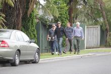 Police officers in plain clothes at a Maketu property. Photo / John Borren
