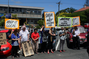Protesters demonstrate outside the Dargaville Court house yesterday. Photo / Annette Lambly