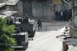 Lebanese soldiers on armored vehicles stage as Lebanese pro-Syrian rebels Sunni gunmen stand in positions during clashes that erupted between pro and anti-Syrian regime gunmen in Lebanon. Photo / AP