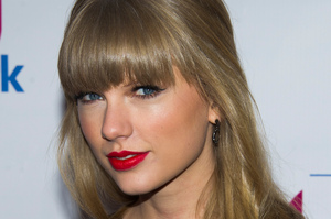 Harry Styles and Taylor Swift had a great time in England. Photo / AP