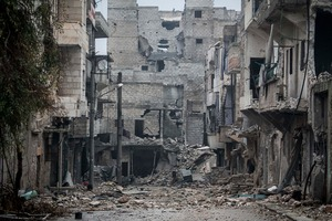 Damaged buildings are seen along a desolate street on the front line after several weeks of intense battles between rebel fighters and troops loyal to Syrian President Bashar al-Assad Aleppo, Syria. Photo / AP