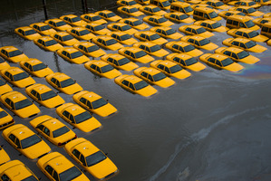 A parking lot full of yellow cabs is flooded as a result of superstorm Sandy in Hoboken.  Photo / AP