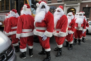 Young minds are sure to wonder how Santa can be everywhere. Photo / AP