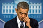 President Barack Obama wipes his eye as he talks about the Connecticut elementary school shooting. Photo / AP