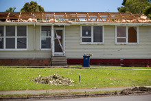 Debris covers much of Wallingford Way, Hobsonville. Photo / Greg Bowker