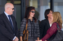 Anita Killeen (in sunglasses) leaving Auckland District Court with supporters this morning after being discharged without conviction. Photo / Sarah Ivey