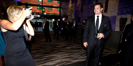 Richie McCaw stops to pose for Getty Images photographer Sandra Mu before the rugby awards ceremony in Auckland last night. Photo / Dean Purcell