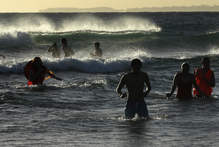 Auckland Council scientists are developing a computer model that will predict, for beach swimmers, the amount of sewage pollution on any given day. Photo / Alan Gibson
