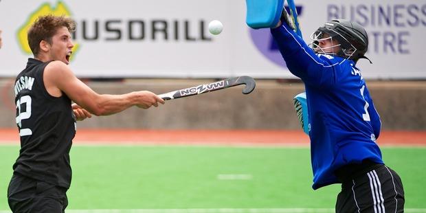 Black Sticks Nick Wilson contests possession with Germany's Nicolas Jacobi. Photo / Photosport
