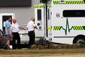 Ambulance staff help a Tamatea Intermediate school student into an ambulance. Photo / Paul Taylor