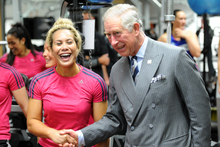 His Royal Highness Prince Charles shakes hands with one of the members of the New Zealand womens sevens rugby team. Photo / Ross Setford