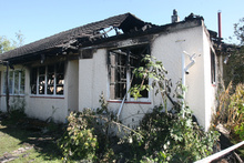 The semi-detached house in William Kemp Place was left gutted after the fire. Photo / APN