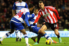 Sunderland's Steven Fletcher, right, vies for the ball with Reading's Shaun Cummings, left, during their English Premier League soccer match. Photo / AP