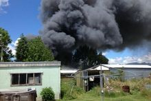Thick smoke bellowed from a shed that had caught alight in Katikati.  Photo / Supplied