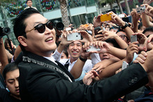 Psy with fans in Bangkok. Photo/AP