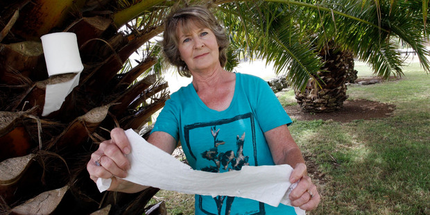 Caroline McLean who lives on Kensington Ave, amongst the palm trees that people use for a toilet stop. Photo / John Stone.