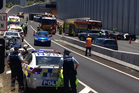 Emergency services attend the scene at the Victoria Park tunnel. Photo / Greg Bowker