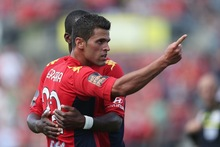 Fabio Ferreira of Adelaide celebrates scoring the third goal with teammate Bruce Djite. Photo / Getty Images