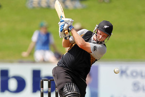Colin Munro of New Zealand hits out during the T20 Tour match between South Africa A and New Zealand. Photo / Getty Images