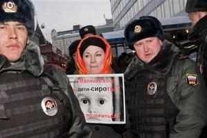 People picket parliament's lower chamber, to protest against planned debate of an amendment that would ban Americans from adopting Russian children.