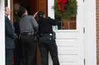 Emergency officals investigate a bomb threat at the St Rose of Lima Roman Catholic Church. Photo / AP