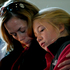 Molly Delaney, left, holds her 11-year-old daughter, Milly Delaney, during a service in honor of the victims who died a day earlier when a gunman opened fire at Sandy Hook Elementary School. Photo / AP