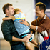 Braith, 6, hugs his uncle Marc Checkley and his partner Szechuin Lee as they arrive at Auckland International Airport from Singapore to spend their Christmas holiday with family. Photo / NZ Herald
