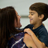 Sebastian Lasuado, 7, hugs his aunt Erica Hussona as he and his family arrive at Auckland International Airport from Doha for the Christmas holidays. Photo / NZ Herald