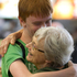Mikael Landels, 15, greets his grandmother Cynthia Landels at the Auckland International Airport, after arriving from Sweden for the Christmas holidays. Photo / NZ Herald