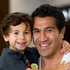 Ex All Black Mils Muliaina (R) with his 4-year-old son Max at Auckland International Airport after arriving from Tokyo, Japan. Photo / NZ Herald