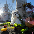 Flowers and stuffed animals of a makeshift memorial for school shooting victims encircle the flagpole at the town center in Newtown. Photo / AP