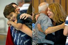 Sabastian Lasuado hugs his aunt, Erica Hussona and Hana Lasuado embraces her father, Ayad Hussona. Photos / Dean Purcell