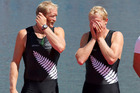 Eric Murray and Hamish Bond stand on the dais after winning gold at the London Olympics. Photo / Brett Phibbs