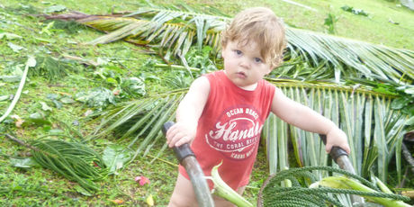 Elijah, 19 months, helps out with Cyclone Evan clean up in Alafua, Samoa. Photo / Vanessa/Supplied